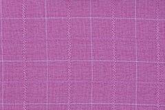 Materiale rosa nella griglia, un fondo del tessuto fotografie stock