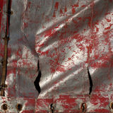 Materiale sintetico misero stracciato macchiato Fotografie Stock