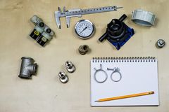 Materialen, toebehoren en vervangstukken voor hydraulica Nota's en m royalty-vrije stock fotografie