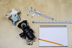 Materialen, toebehoren en vervangstukken voor hydraulica Nota's en m stock afbeeldingen