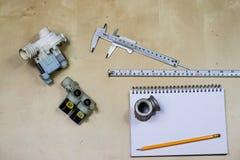 Materialen, toebehoren en vervangstukken voor hydraulica Nota's en m royalty-vrije stock foto's