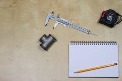 Materialen, toebehoren en vervangstukken voor hydraulica Nota's en m stock fotografie