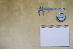 Materialen, toebehoren en vervangstukken voor hydraulica Nota's en m stock foto