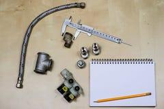 Materialen, toebehoren en vervangstukken voor hydraulica Nota's en m stock foto's