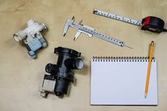 Materials, accessory and spare parts for hydraulics. Notes and m stock image