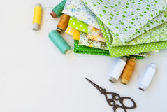 Materials at hand sewing on white Royalty Free Stock Photos