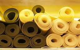 Materials for yoga classes, mats, bricks and straps, bowl for meditation. everything you need for yoga. Stock Photos