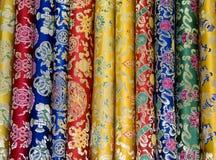 Materias textiles florales tibetanas Foto de archivo