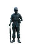 Materielfoto - den klippta ut statyn av soldaten, kan användas på någon mili Arkivbild
