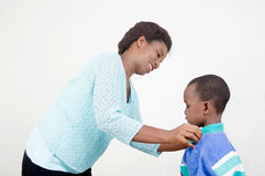 Maternal tenderness. This smiling mother cares for her son Royalty Free Stock Image