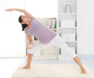 Maternal yoga at home Royalty Free Stock Image