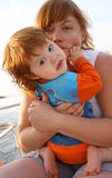 Maternity. Young mother with her beloved young baby girl on boat Stock Image