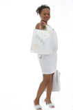 Maternity. Beautiful pregnant woman with shopping bags for baby Stock Photography