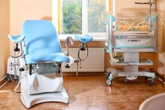 Maternity chair in examination room. Maternity chair in the surgical obstetric ward. Chair for inspection of pregnant women. Inspection room in the hospital stock photography