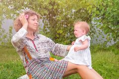 Maternity leave background. Mother and child. Parenting concept. Mother with child on her knees. Maternity leave background. Young mother playing with her baby royalty free stock image