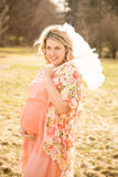 Maternity Portrait. Portrait of an expecting mother in early spring Royalty Free Stock Photos