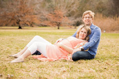Maternity Portrait. Portrait of an expecting mother and father in early spring Royalty Free Stock Photo