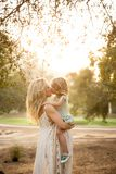 Maternity sibling pregnant kiss Stock Photo