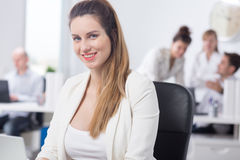 Maternity and work in corporation Stock Photo