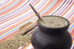 Matero with yerba mate on colorful stripes Stock Photos