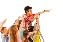 Mates competition boy climb up other pull down Royalty Free Stock Photo