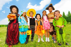 Mates in Halloween costumes stand close together Royalty Free Stock Photo