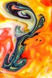 Matfärg mjölkar på abstrakt bakgrund, marmor som Arkivfoton