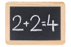 Mathématiques sur un tableau noir ou un tableau Images stock