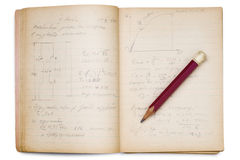 Math. An open math notebook on white with pencil on it Royalty Free Stock Photo