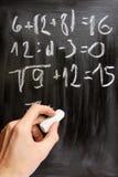 Math. Writing with chalk on blackboard stock photo