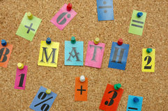 Math. Ematical symbols pinned on noticeboard royalty free stock photography
