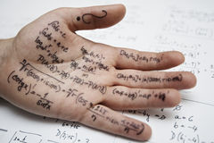 Math. Hand of student with cheat sheet for math exam - selective focus Royalty Free Stock Image
