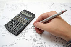 Math. Pencil,calculator,math book and student hand Royalty Free Stock Photos