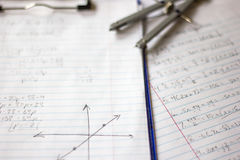 Math and Algebra Homework. Math Algebra equations graphs coordinates homework stock photo