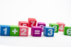 Math blocks. Colorful children's blocks with numbers and mathematical symbols on white background Royalty Free Stock Image