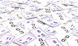 Math Cards. Addition Math Cards (blue) Subtraction Math Cards (black) randomly spread out on table. Educational School Supplies Royalty Free Stock Images