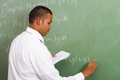 Math class. Young male indian teacher during math class Stock Photos