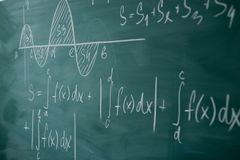Math class. Algebra. Graph and formulas are written on the school board.  stock photo