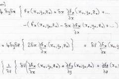 Math class. Hand written study notes for math with equations for divergence of fields stock photography