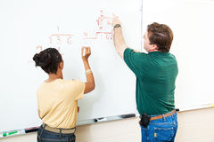 Math Class - Student and Teacher Royalty Free Stock Photos