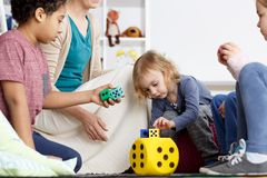 Math classes in kindergarten. Math classes for preschoolers connected with fun in kindergarten royalty free stock image