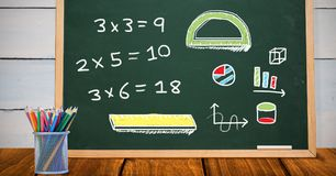 Math drawings on education blackboard in school. Digital composite of Math drawings on education blackboard in school royalty free stock photo