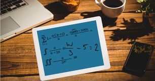 Math equation of tablet PC's screen at outdoor cafe. Digital composite of Math equation of tablet PC's screen at outdoor cafe stock images