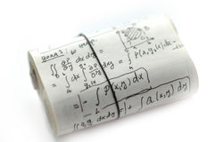 Math Equations. High key rolled paper with mathematical equations royalty free stock photos