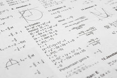 Math equations. Printed paper full of math equation symbols stock image