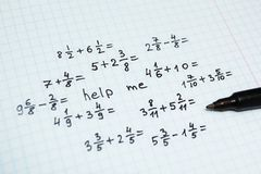 Math examples in the notebook in the cage, the inscription - help me royalty free stock photo