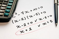 Math exercise with calculator and pen. Close up of math exercise, handwritten Royalty Free Stock Photos