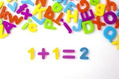 1+1=2 math formula. Addition formula with alphabet toys Stock Image