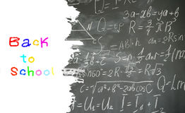 Math formulas on black board. School background with math formulas written in white chalk on black board border with copy space Royalty Free Stock Images