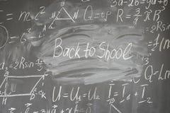 Math formulas on black board. Formulas written in white chalk and back to school written words on blackboard royalty free stock photography
